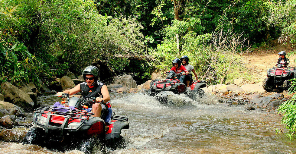 Costa Rica ATV adventure group driving through crossing river