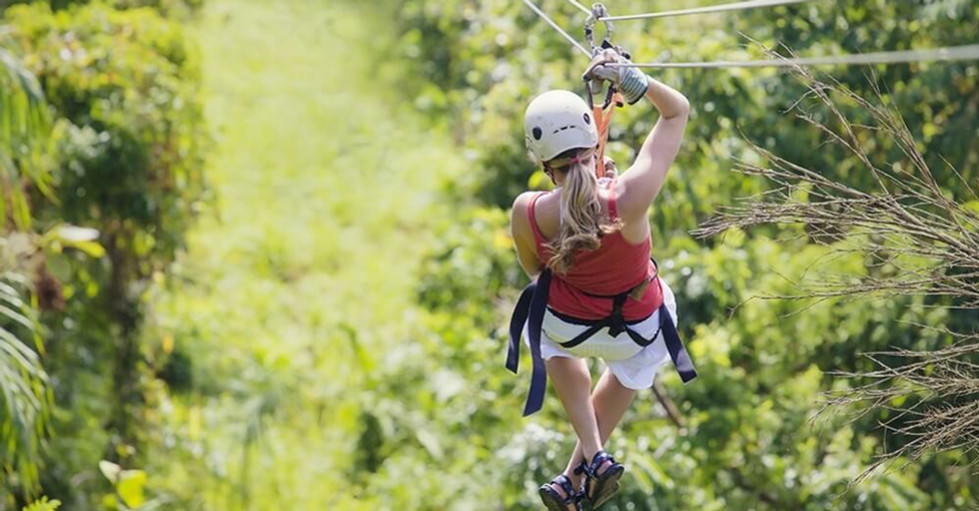 ziplining in Costa Rica woman zipping on cable