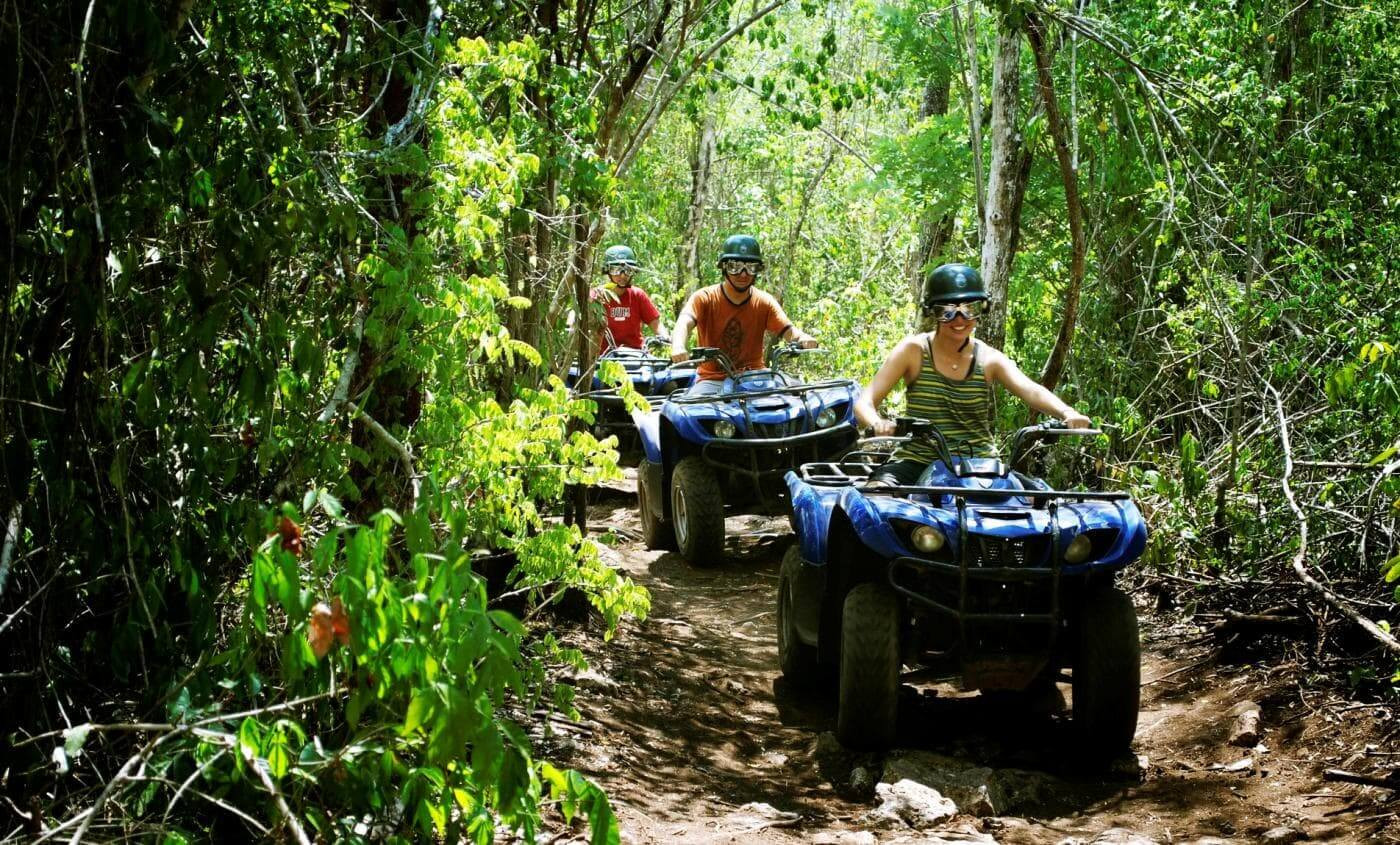 Costa Rica ATV adventure group driving on jungle rainforest trail
