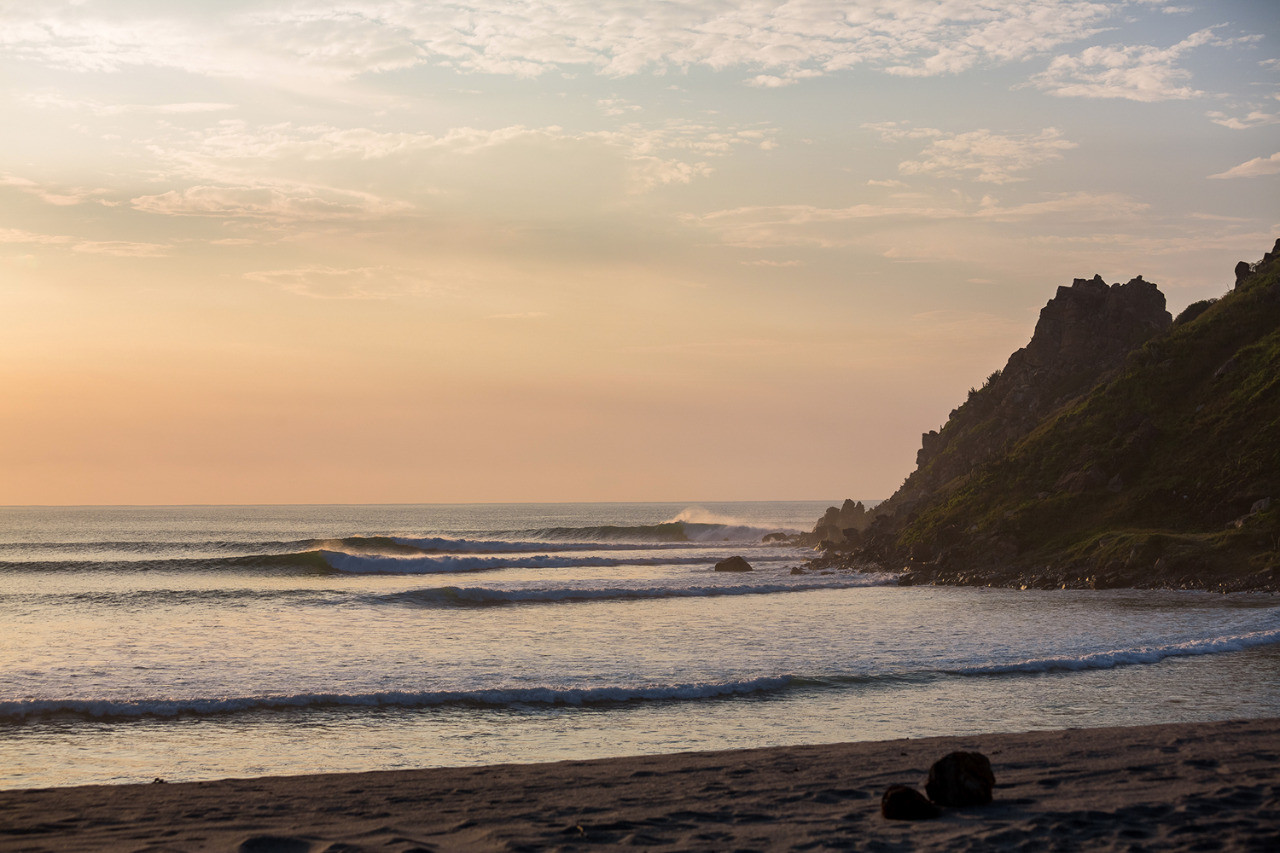 Salina Cruz Surf Camp sunset at one of the best surf spots in Mexico with waves rolling in