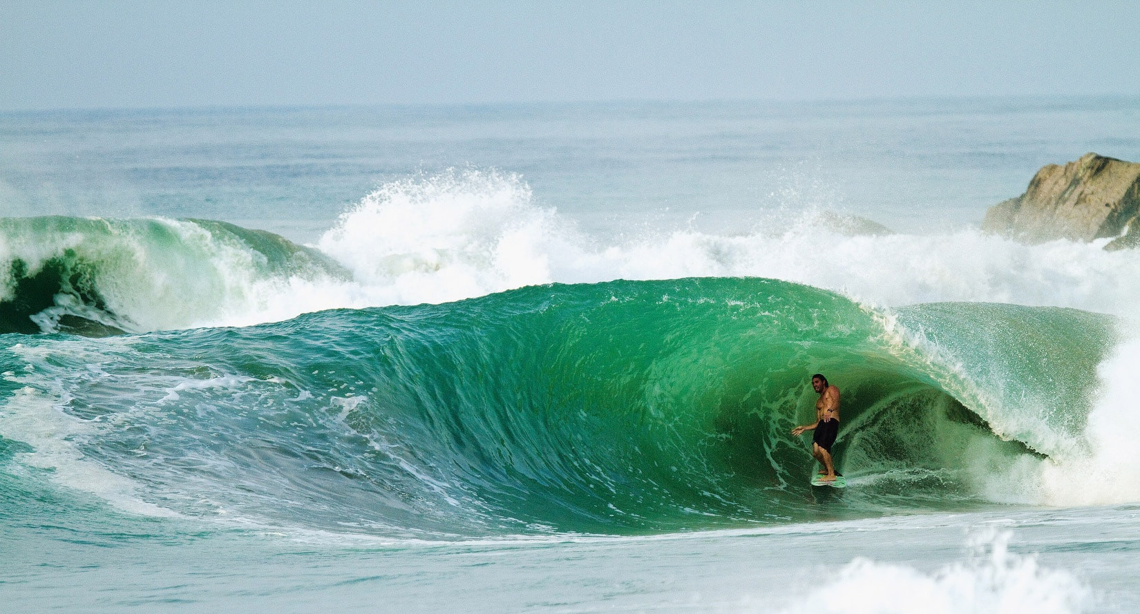 Salina Cruz Surf Camp standing in an epic right point break tube