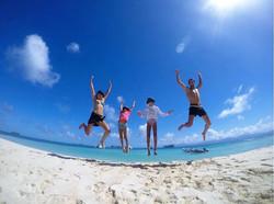Happy Roca family jumping San Blas