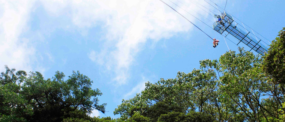 Monteverde Costa Rica zipline adventure guest jumping off tarzan swing