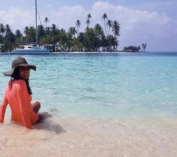 Marie sitting in ocean San Blas