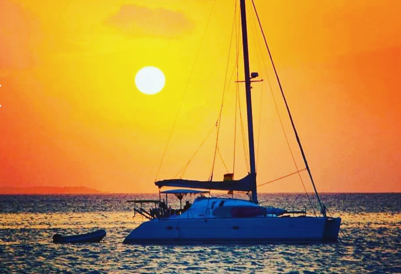 Catamaran and dinghy sunset San Blas