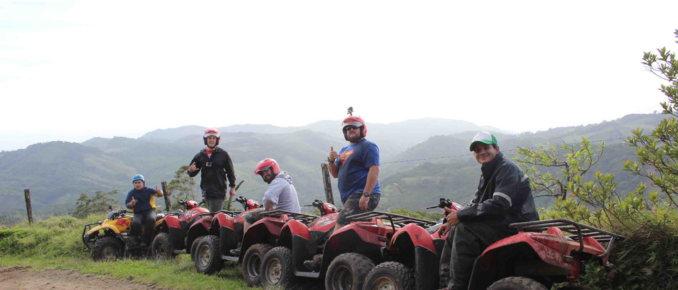 Monteverde Costa Rica ATV adventure tour group resting on side of the road with mountain views