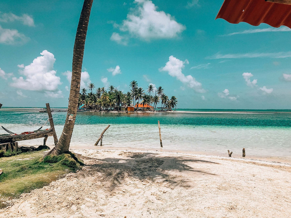 two san blas panama islands with clear skies and ocean
