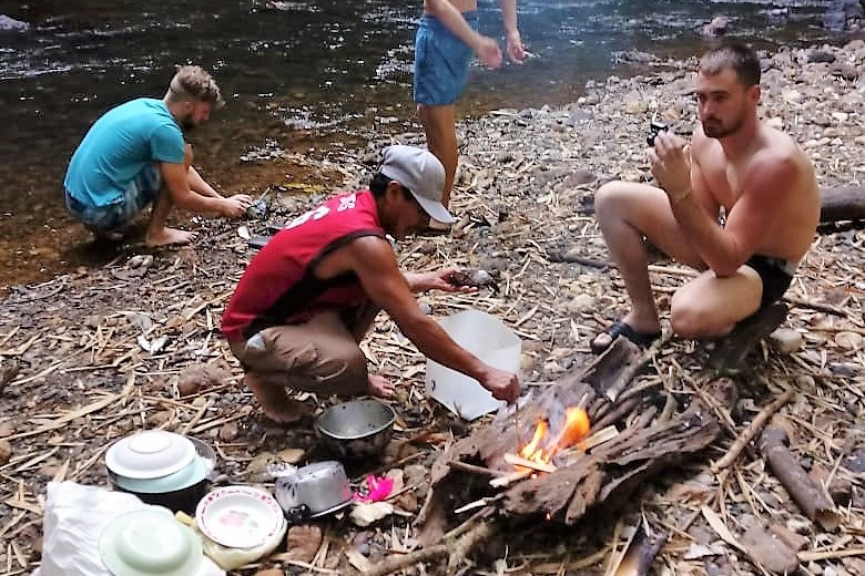 Darian Gap Jungle expedition with guide preparing dinner over fire