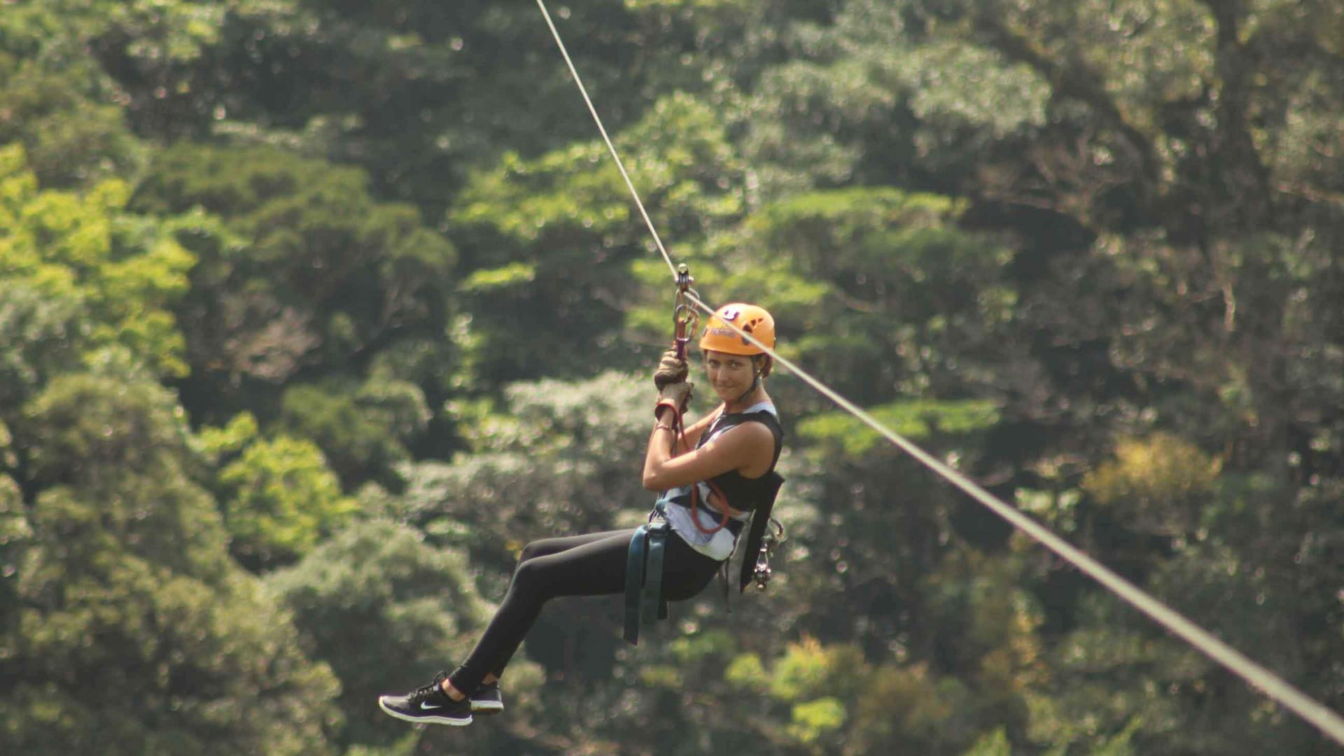 Monteverde Costa Rica zipline adventure guest hanging and zipping accross