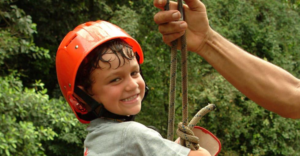 costa Rica child zipline getting ready to zip into nature