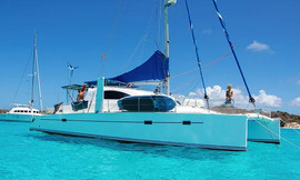 San Blas catamaran sailing charter anchored with guests aboard