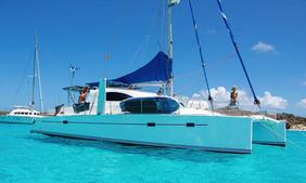 San Blas catamaran sailing charter anchored with guests aboard