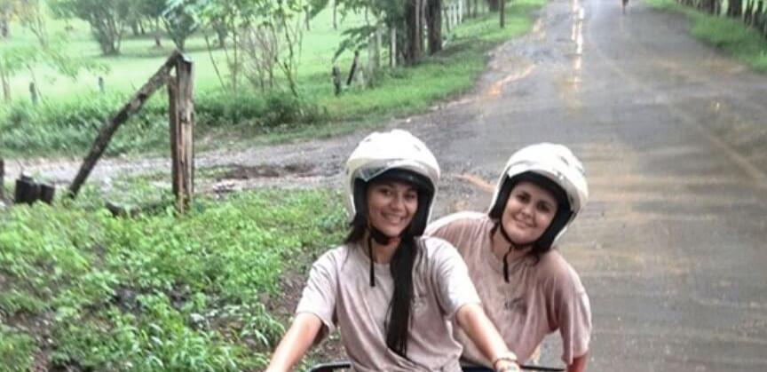 Tamarindo Guanacaste ATV adventure tour two women riding their ATV and smiling