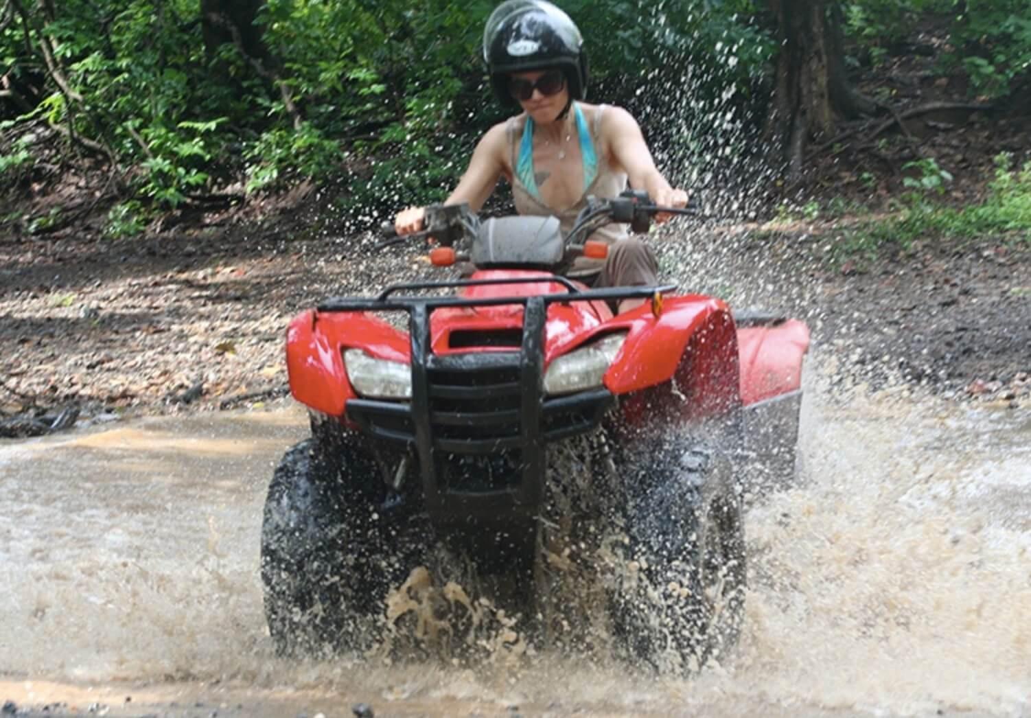 Tamarindo Guanacaste ATV adventure tour guest crossing a river