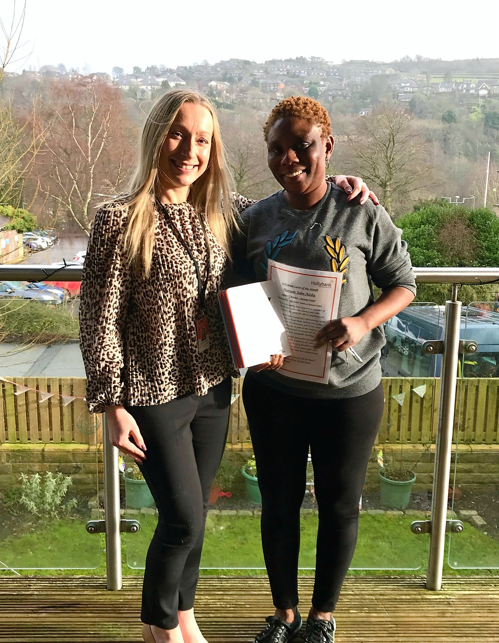 Miriam John-Aloba receives her Carer of the Month award.