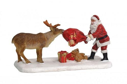 Reindeer teasing santa