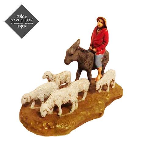 Campesino con asno y ovejas