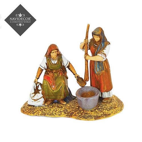 Campesinas moliendo el trigo