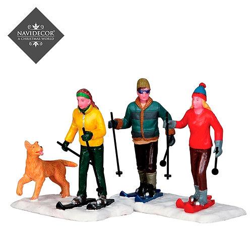Esquiadores con peroo