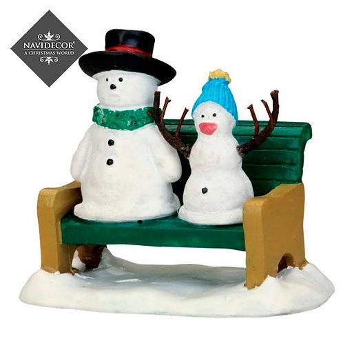 Banco con dos muñecos de nieve