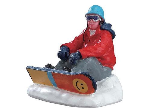 Snowboarder descansando