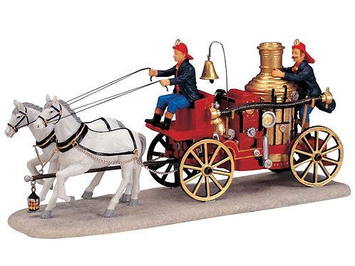 Bomberos con carro de caballos
