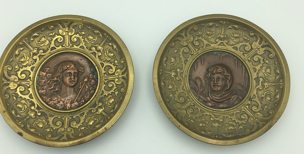 Pair embossed metal plates