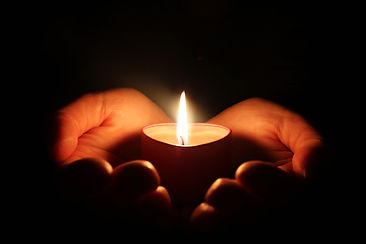 candle-hand-dark.jpg