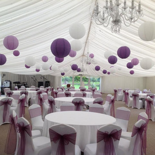Lilac, purple and natural coloured paper lanterns.