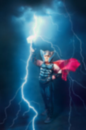 little boy in thor costume with lightnin