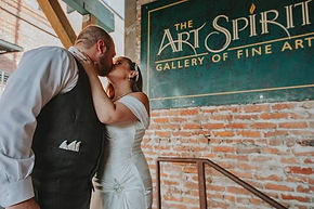 bride_groom_reception_brickwall.jpeg