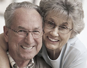 mature couple wearing eye glasses
