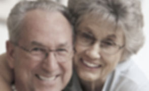 Older M-F couple with glasses