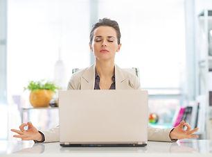 business-woman-meditating-near-laptop-50