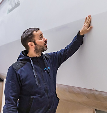 Managing Director of OQS Tomas Halmesmäki inspects the quality of workmanship by his team
