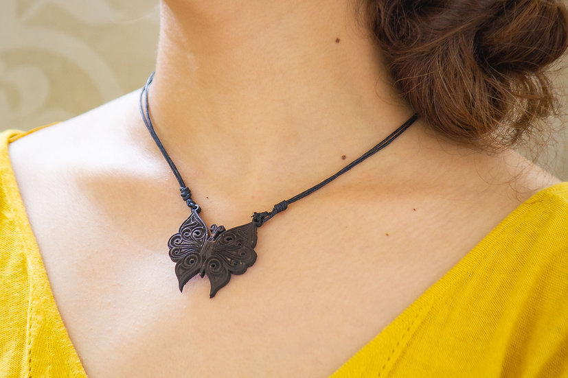 Moth Coconut Shell Pendant by EarthCare Designs Foundation