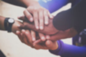 diverse-group-of-people-holding-hands-in