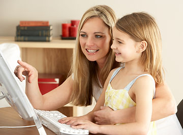 Parent and child researching camps.