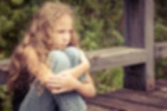 Sad girl at camp.