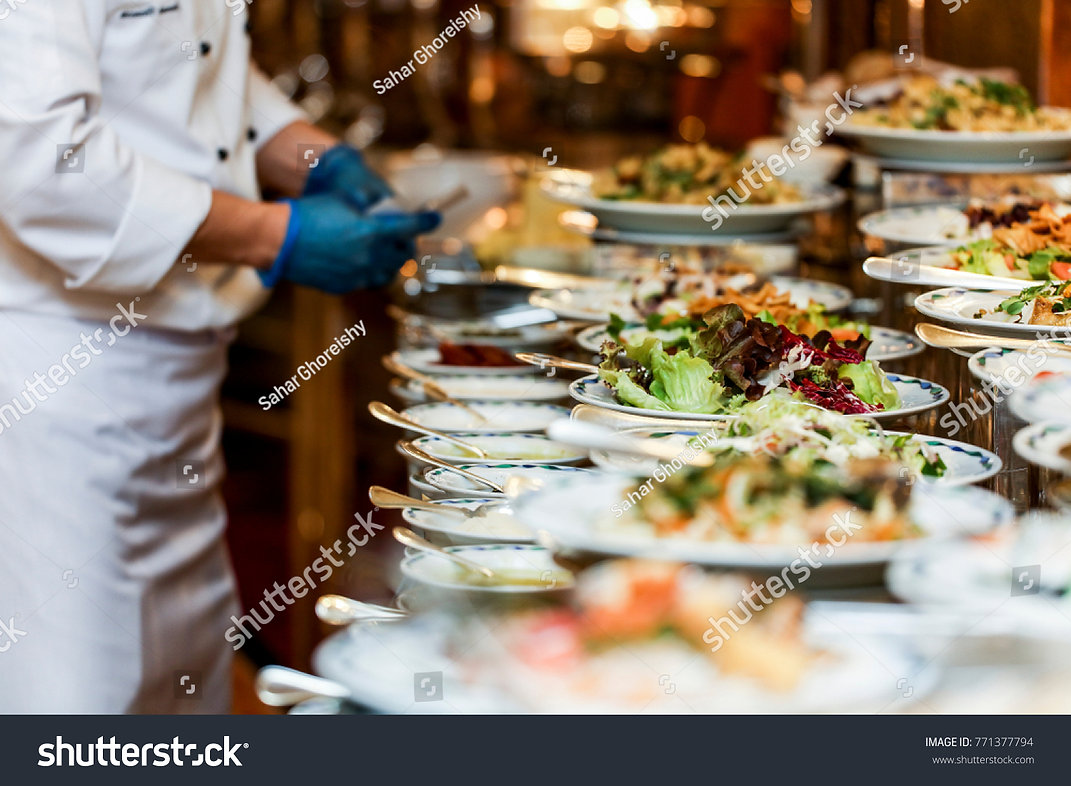 chef-is-arranging--buffet-table.jpg