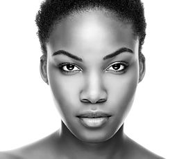 Face of an young black beauty in black a