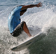 pedro cruz doing a snap during an advanced surf lesson in tamarindo costa rica