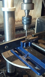 Drilling a hole in the GIB tension arm. Accuracy and alignmen are important, so a drill press is helpful.