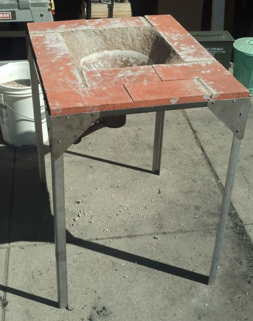 The firebrick forge table, with all parts in place, including fire clay.