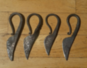 Four hand made iron age womens' knives