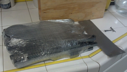 Inside the protective plywood box, the pieces were wrapped in plastic to protect against moisture.