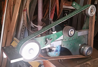 "The grinder-in-a-box with a 5"" contact wheel on a slack belt tool arm."