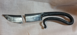 Blacksmith's knife of salvaged mystery steel, broken during heat treat.