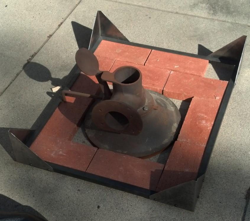 Laying out the brick pattern around the firepot.