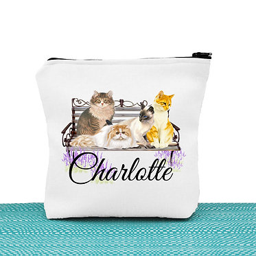 White cosmetic toiletry bag with zipper personalized with name and cats on bench image front view